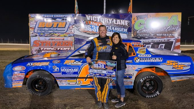Mike Nichols moved to the top of IMCA's all-time wins list with his career 558th IMCA Sunoco Stock Car feature win on Sept. 3 at Abe's U.S. 30 Speedway in Columbus, Neb. He is pictured in victory lane with wife Anita. (Photo courtesy of Abe's U.S. 30 Speedway)
